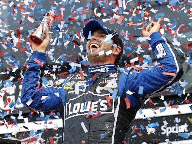 Jimmie Johnson celebrates after winning the Daytona 500 NASCAR Sprint Cup Series auto race, Sunday, Feb. 24, 2013, at Daytona International Speedway in Daytona Beach, Fla. (AP Photo/Terry Renna)