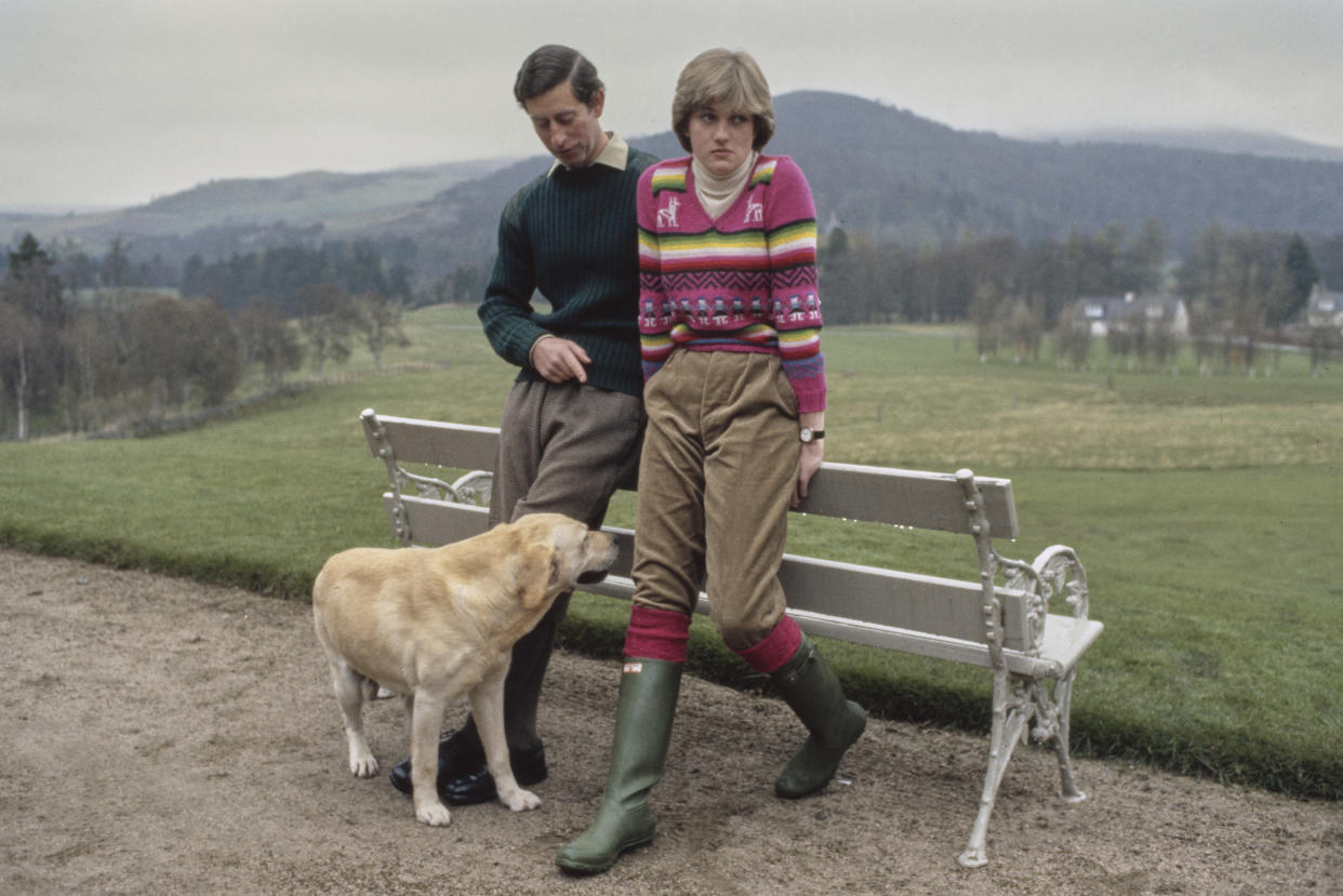Prince Charles and Lady Diana Spencer (later Diana, Princess of Wales, 1961 - 1997) hold a photocall with their dog Harvey at Craigowan Lodge in Balmoral, Scotland, 6th May 1981. This was their first official photocall after their engagement. Diana is wearing an Inca jumper with green corduroy trousers and Hunter boots. (Photo by Tim Graham/Getty Images)