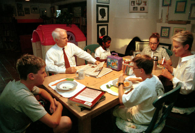 <p>Presidential candidate John McCain with wife Cindy in their home in Phoenix, Ariz., with their children. The oldest daughter is Meghan, their adopted daughter is Bridgette, and their two sons, Jack and Jimmy, October 14, 1999. (Photo: Karin Cooper/Hulton Archive via Getty Images) </p>