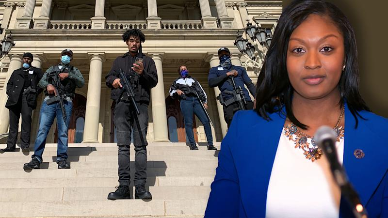 Activists prepare to escort Rep. Sarah Anthony into the Michigan state Capitol; Rep. Sarah Anthony