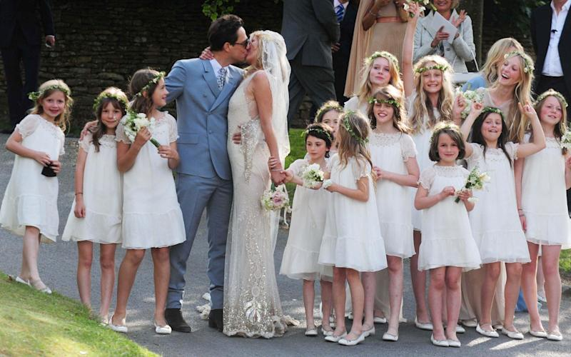 Kate Moss's wedding to Jamie Hince featured more than a dozen bridesmaids, flouting Country Life's advice that smaller is better - PA