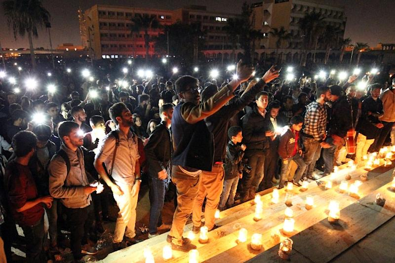 """AFP photographer Abdullah Doma covered this event of Libyans attending a candlelit concert marking """"Earth Hour"""" in Benghazi on March 25, 2017 to raise awareness of climate change by participating in a world-wide initiative to turn off the lights"""