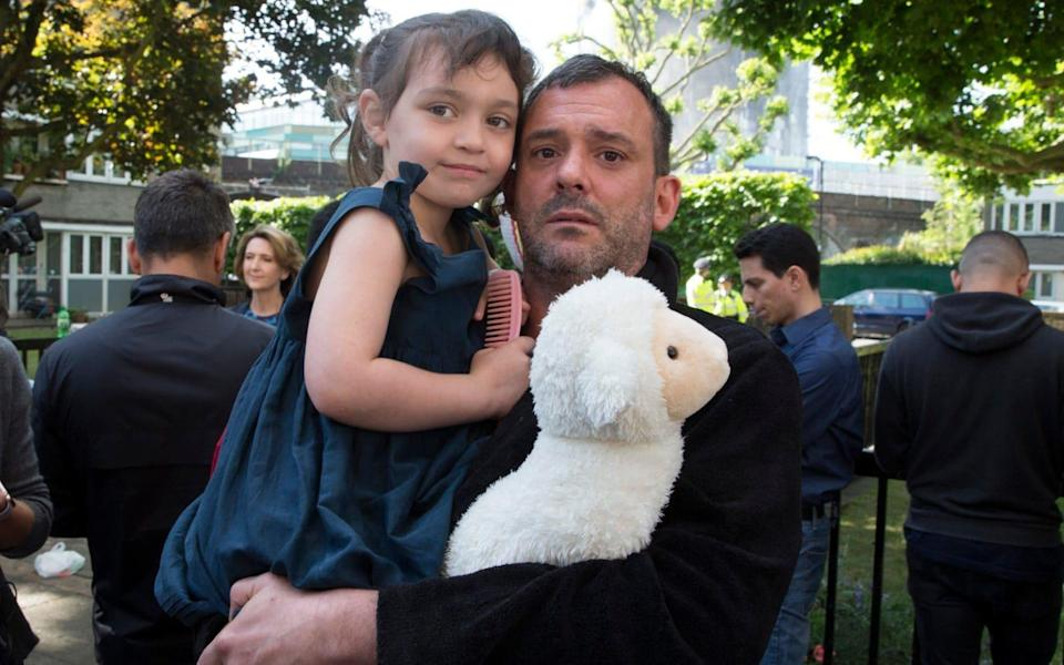 Michael Paramasivan with his step daughter Thea Kavanagh aged 5. They escaped form the 7th floor . - Credit: Heathcliff O'Malley for The Telegraph