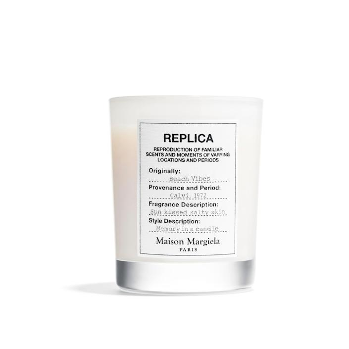 """Maison Margiela has crafted a unique recipe to bring the ocean air to your home with hints of coconut milk, pink pepper, and bergamot. $62, Sephora. <a href=""""https://www.sephora.com/product/maison-margiela-replica-beach-vibes-scented-candle-P466666"""" rel=""""nofollow noopener"""" target=""""_blank"""" data-ylk=""""slk:Get it now!"""" class=""""link rapid-noclick-resp"""">Get it now!</a>"""