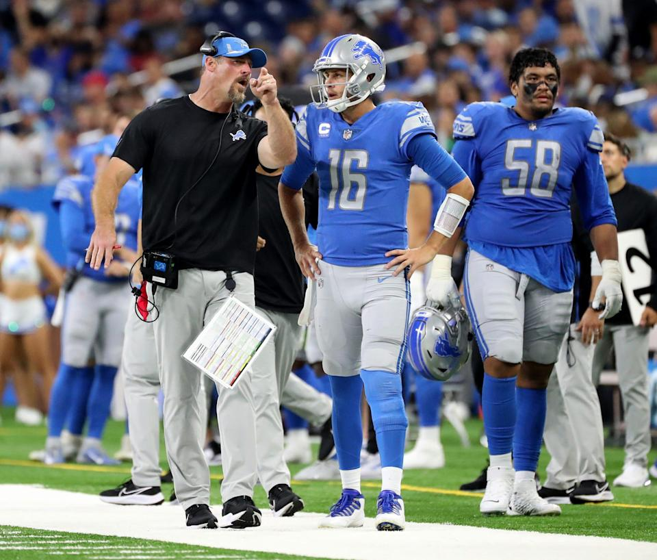 Head coach Dan Campbell talks with Detroit Lions quarterback Jared Goff during action against the San Francisco 49ers, Sunday, September 12, 2021 at Ford Field.