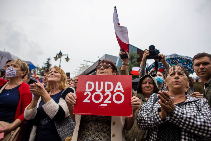 Supporters of Polish President Andrzej Duda listen to speeches during election rally in Kwidzyn