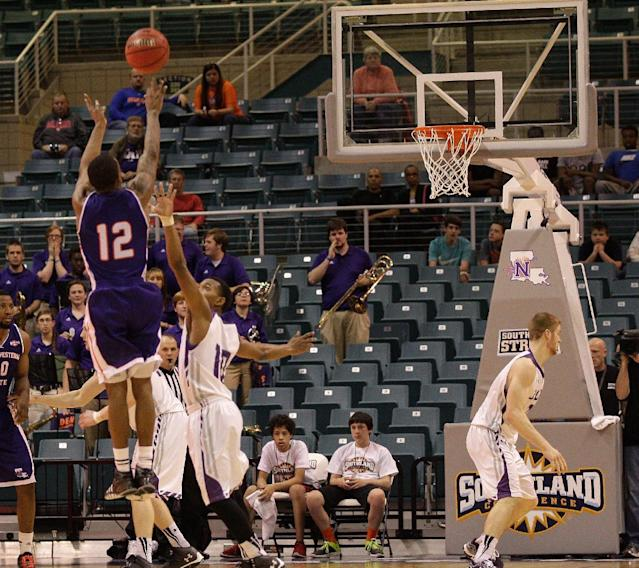 Northwestern State's Jalan West (12) makes a three-point shot over Stephen F. Austin Trey Pinkney (10 ) during the second half of an NCAA college basketball game in the semifinal round of the Southland Conference tournament Friday, March 14, 2014, in Katy. (AP Photo/Bob Levey)