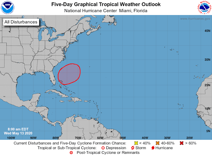 A tropical or subtropical storm should form in the red shaded area within the next five days, forecasters said.