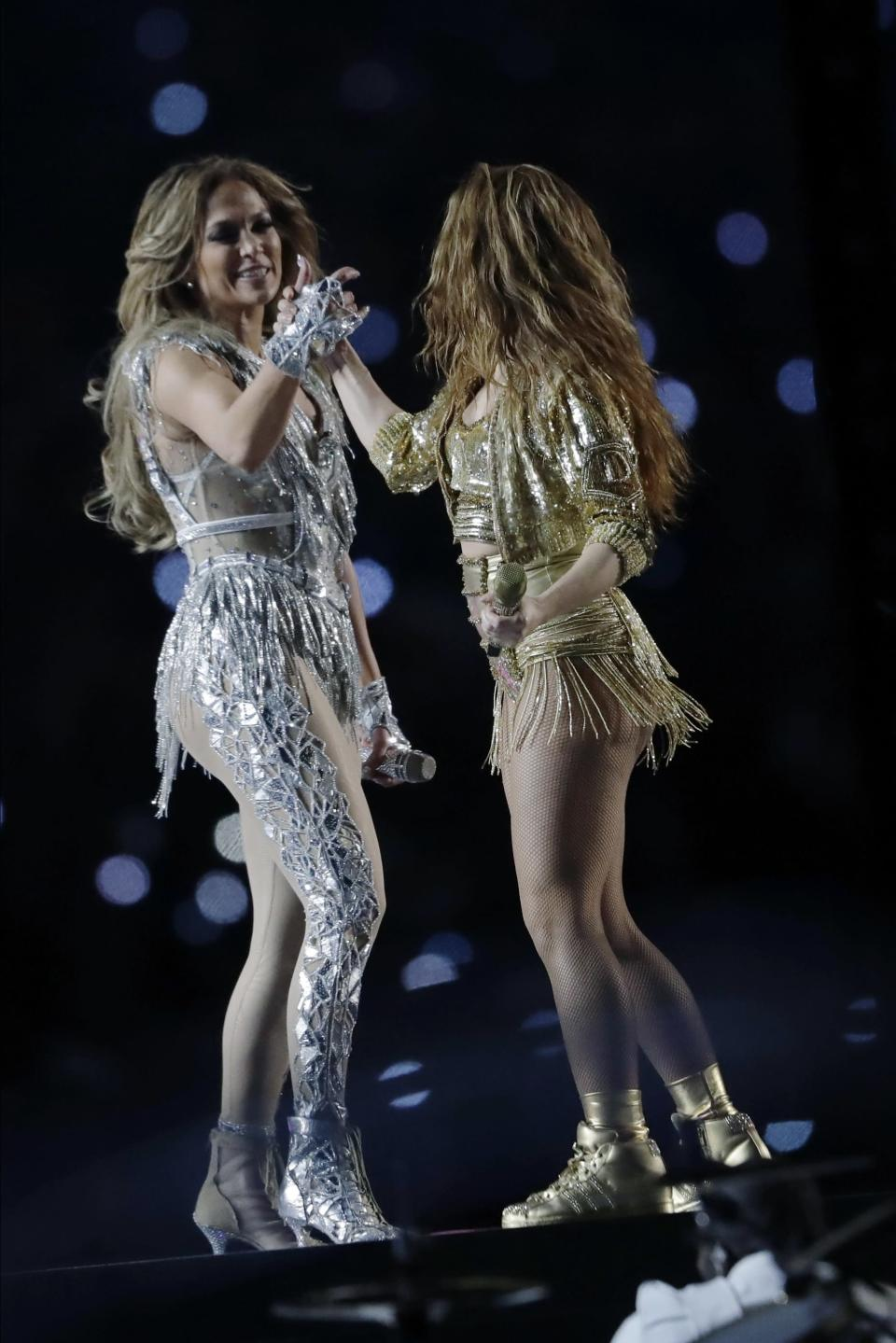 Jennifer Lopez, left, and Shakira perform during halftime of the NFL Super Bowl 54 football game between the San Francisco 49ers and the Kansas City Chiefs Sunday, Feb. 2, 2020, in Miami Gardens, Fla. (AP Photo/John Bazemore)