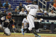 Miami Marlins Jazz Chisholm Jr. hits his second home run of a baseball game during the fifth inning against the Washington Nationals, Monday, Sept. 20, 2021, in Miami. (AP Photo/Marta Lavandier)