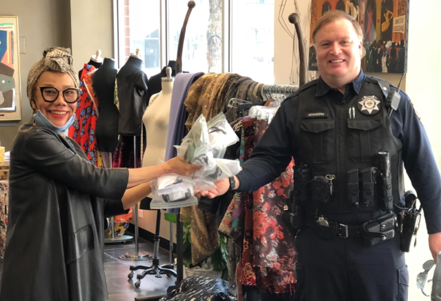 Barbara Bates hands masks to a police officer at her studio in Chicago. (Courtesy of Barbara Bates)