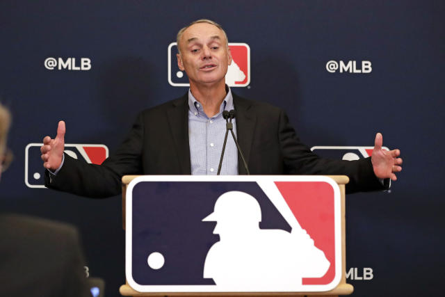 MLB commissioner Rob Manfred and the players' union haven't been able to agree on several issues, including the length of the shortened season. (AP Photo/John Raoux)