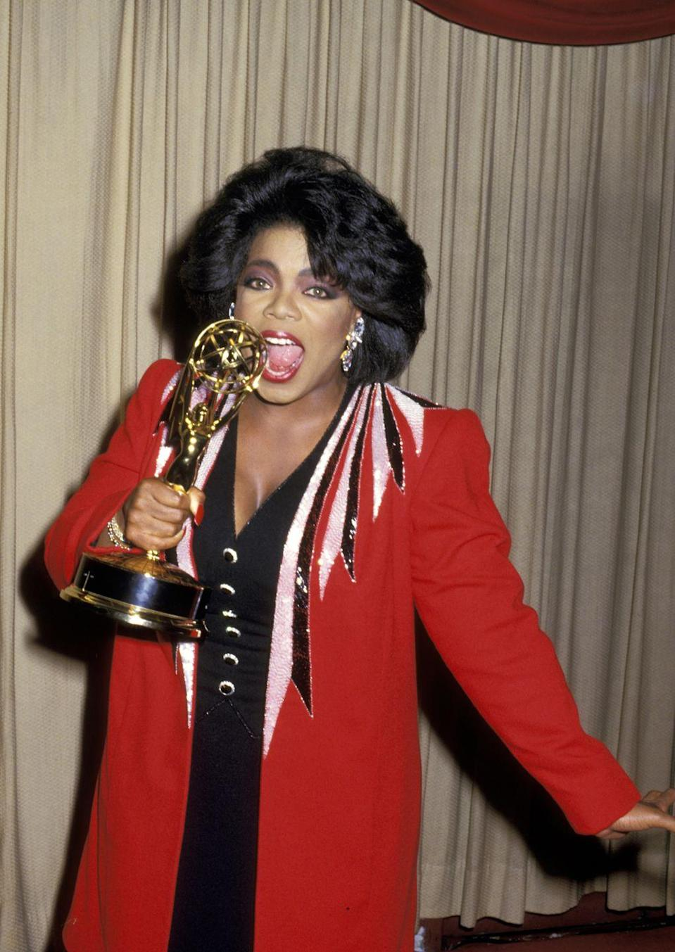 <p>Take a tip from Oprah, and match your eyeshadow with your 'fit. Here, she donned a blazer with sequin detailing at the shoulders over a black V-neck dress. She picked up her award this year for Outstanding Talk Show Host. </p>