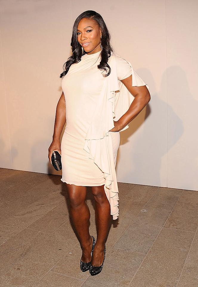 "Tennis star Serena Williams rocked up to the largest public fashion show in New York City's history sporting a sexy draped number and sparkling black heels. Gary Gershoff/<a href=""http://www.wireimage.com"" target=""new"">WireImage.com</a> - September 7, 2010"