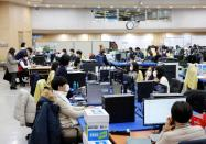 City employees work at Incheon city's coronavirus response command center in Incheon