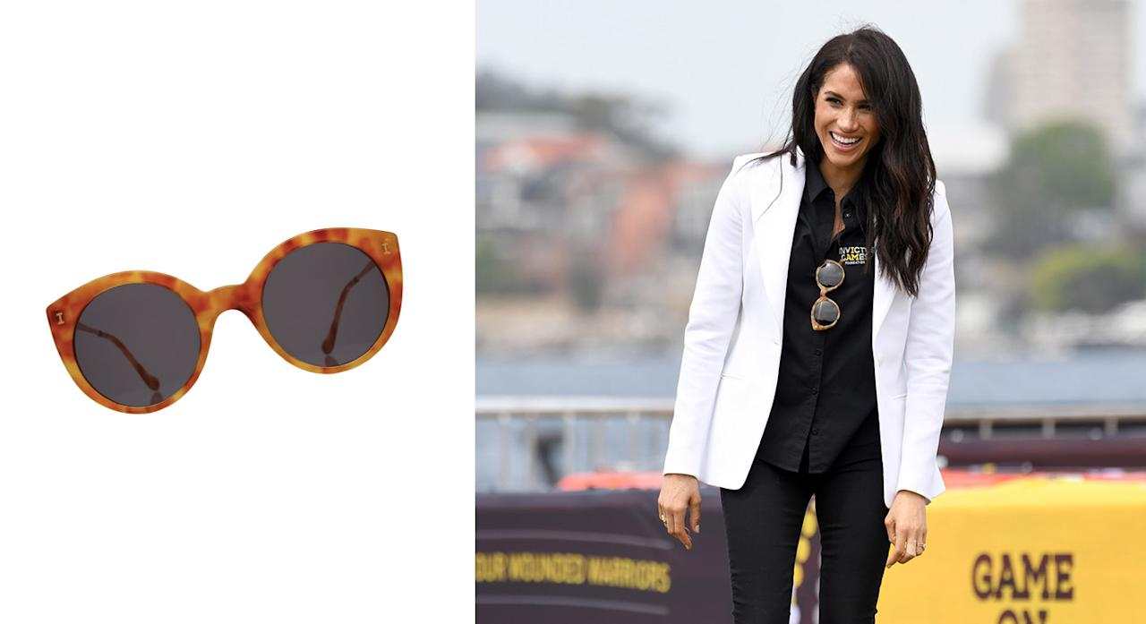 """<p>On October 20, Meghan made a stylish return to the Invictus Games in an Altuzarra blazer and Mother Denim jeans but it was her sunglasses which proved a hit on social media. The $240 (approximately £184) shades are from Illesteva and are sure to sell out so make sure to hurry… <a rel=""""nofollow"""" href=""""https://illesteva.com/products/palm-beach-sunglasses-amber""""><strong>Shop now</strong></a>. <em>[Photo: Getty]</em> </p>"""