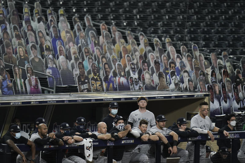 New York Yankees players watch from the dugout during the ninth inning in Game 5 of a baseball American League Division Series against the Tampa Bay Rays, Friday, Oct. 9, 2020, in San Diego. (AP Photo/Jae C. Hong)
