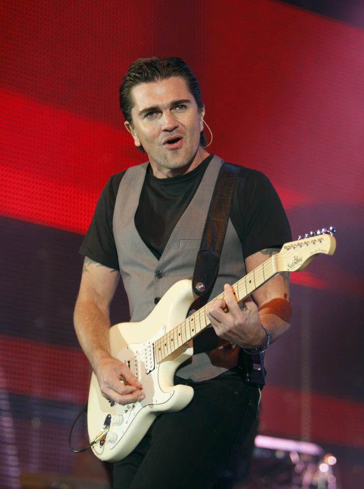 FILE - In this March 10, 2011 file photo, Colombian singer Juanes, performs in Seattle, Wash., at the start of his world tour.