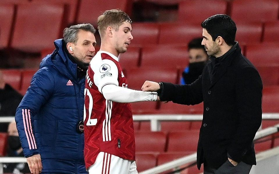 Emile Smith Rowe and Mikel Arteta —Emile Smith Rowe and Bukayo Saka puts smile on face of manager Mikel Arteta - GETTY IMAGES