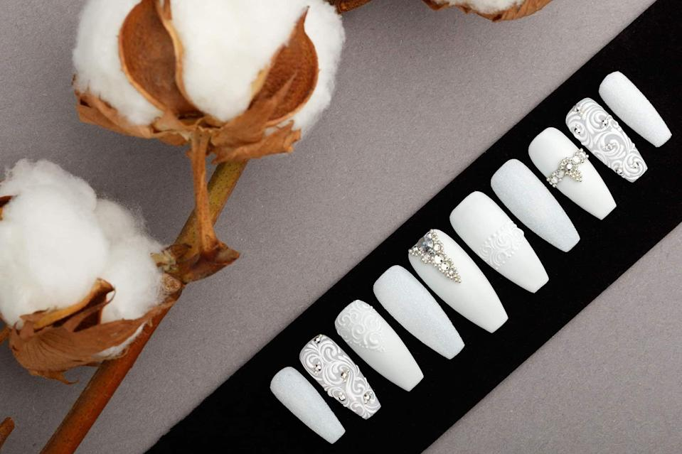 "<p><strong>Lilium Nails</strong></p><p>liliumnails.com</p><p><strong>$69.95</strong></p><p><a href=""https://liliumnails.com/product/all-white-press-on-nails-with-rhinestones/"" rel=""nofollow noopener"" target=""_blank"" data-ylk=""slk:SHOP NOW"" class=""link rapid-noclick-resp"">SHOP NOW</a></p><p>Planning a wedding? <strong>A set of opulent press-on nails from Lilium's Wedding Collection created for bridal looks will look stunning on the big day</strong>. You can find a ton of gorgeous designs for other occasions as well. Some of the sets can be a bit pricey, but it's totally worth it considering the high quality and artistry. Since a set only comes with 10 press-ons, you'll need to plan ahead and get the sample sizing kit if you don't already know your size.</p>"