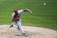 Cincinnati Reds relief pitcher Amir Garrett throws during the eighth inning of a baseball game against the Milwaukee Brewers Saturday, Aug. 8, 2020, in Milwaukee. (AP Photo/Morry Gash)