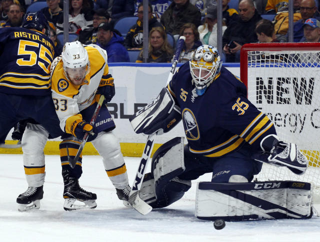 Buffalo Sabres goalie Linus Ullmark (35) stops Nashville Predators forward Viktor Arvidsson (33) during the second period of an NHL hockey game Monday, March 19, 2018, in Buffalo, N.Y. (AP Photo/Jeffrey T. Barnes)