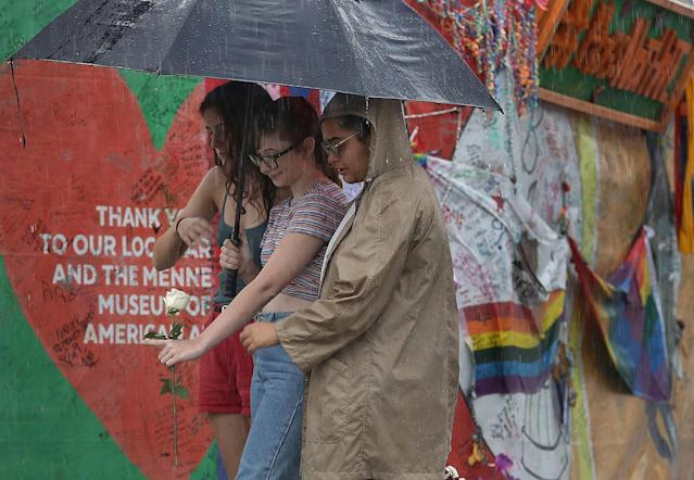<p>Madison Fisher, Sarah Partenio and Immanuelle Craan (L-R) visit the memorial to the victims of the mass shooting setup around the Pulse gay nightclub one day before the one year anniversary of the shooting on June 11, 2017 in Orlando, Florida. (Joe Raedle/Getty Images) </p>