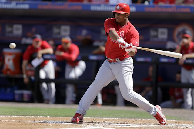 St. Louis Cardinals' Oscar Taveras hits a double during the second inning of an exhibition spring training baseball game against the New York Mets Friday, March 7, 2014, in Port St. Lucie, Fla. (AP Photo/Jeff Roberson)