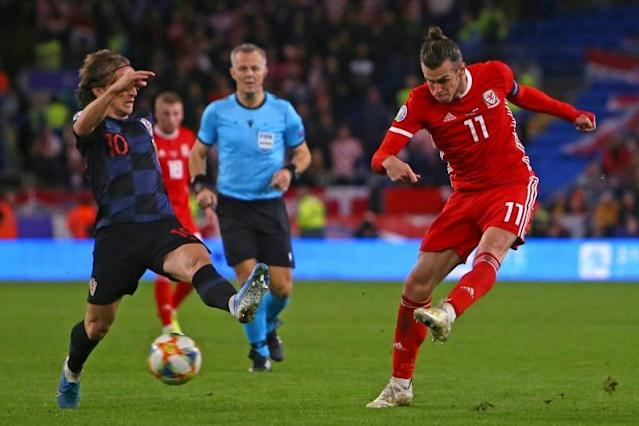 Gareth Bale (R) and Luca Modric (L) were both injured during during the Euro qualifier between Wales and Croatia this week and will miss Real Madrid's meeting with Real Mallorca (AFP Photo/GEOFF CADDICK)