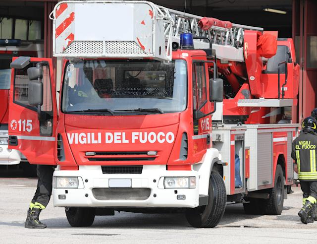Rome, RM, Italy - May 23, 2019: red fire engine with text VIGILI DEL FUOCO that means Firemen in Italian Language. 115 is the number to call in case of emergency