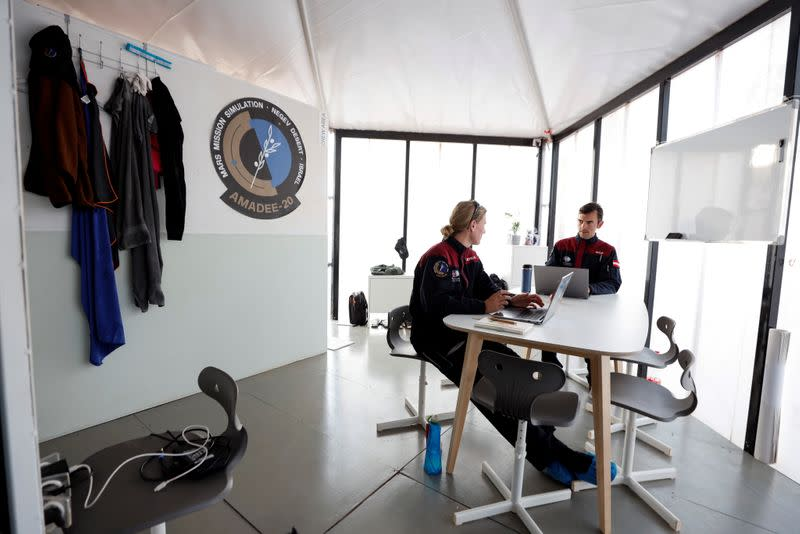 Scientists sit together at the facility during a demonstration of an experiment led by Austrian and Israeli agencies simulating a mission to Mars near Mitzpe Ramon, Israel
