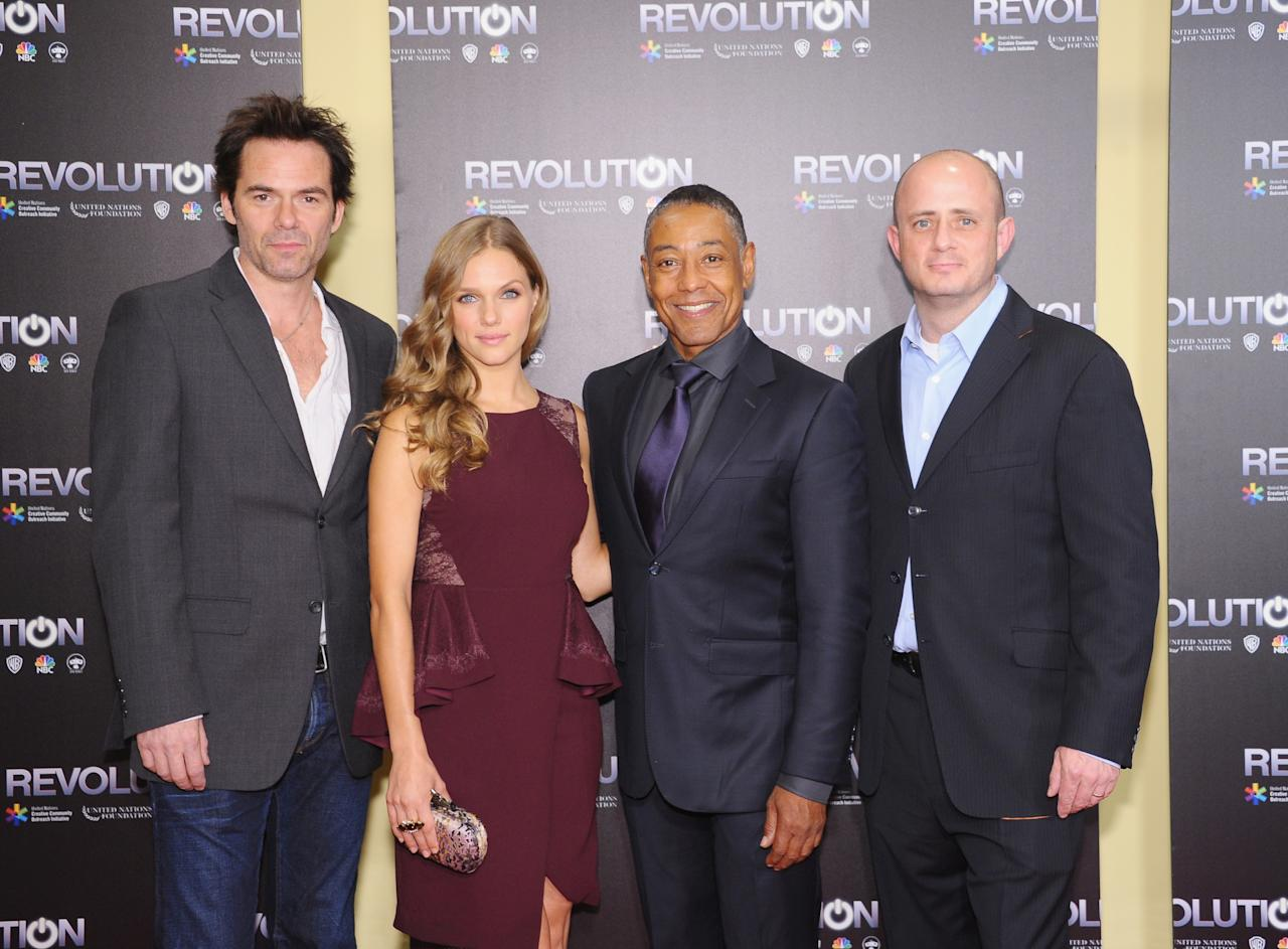 """NEW YORK, NY - SEPTEMBER 17: (L-R) Actors Billy Burke, Tracy Spiridakos, Giancarlo Esposito and executive producer Eric Kripke attend the """"Revolution: The Power of Entertainment"""" season two premiere at United Nations Headquarters on September 17, 2013 in New York City. (Photo by Michael Loccisano/Getty Images)"""