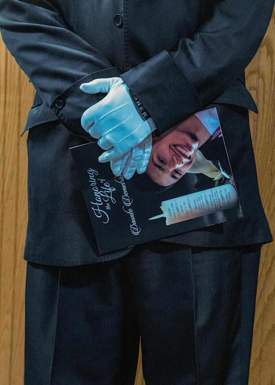 """An usher holds a memorial booklet at the funeral for 20-year-old Daunte Wright, who was shot and killed by police officer in Brooklyn Center, Minn.<span class=""""copyright"""">Ruddy Roye for TIME</span>"""