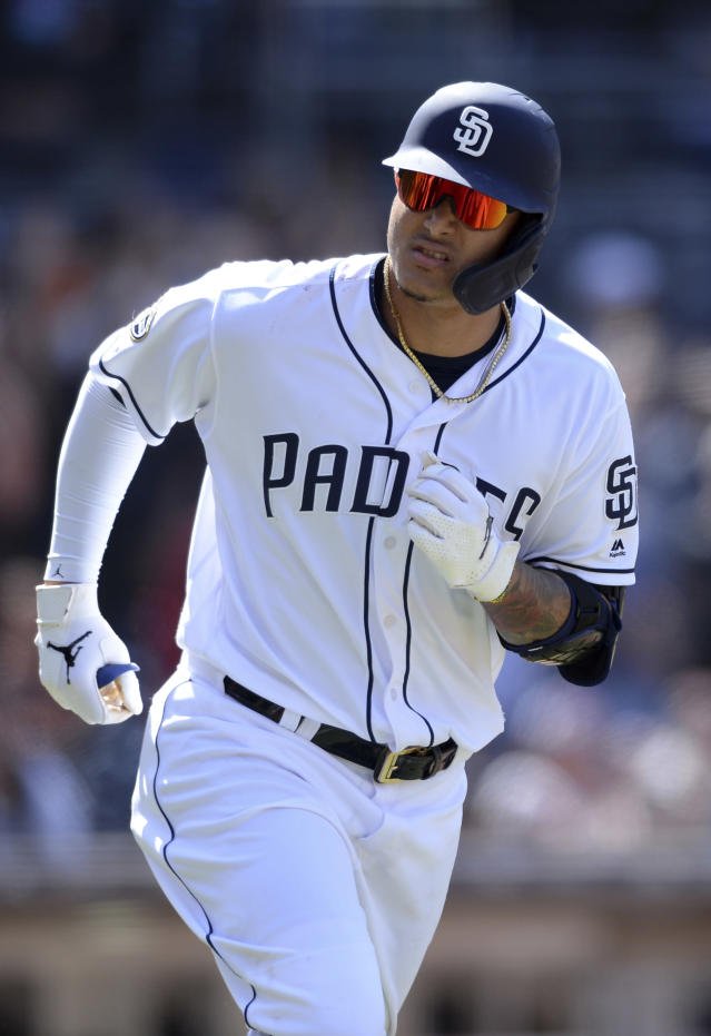 San Diego Padres' Manny Machado looks over to the dugout as he rounds the bases after hitting a two-run home run during the seventh inning of a baseball game against the Arizona Diamondbacks Wednesday, April 3, 2019, in San Diego. (AP Photo/Orlando Ramirez)