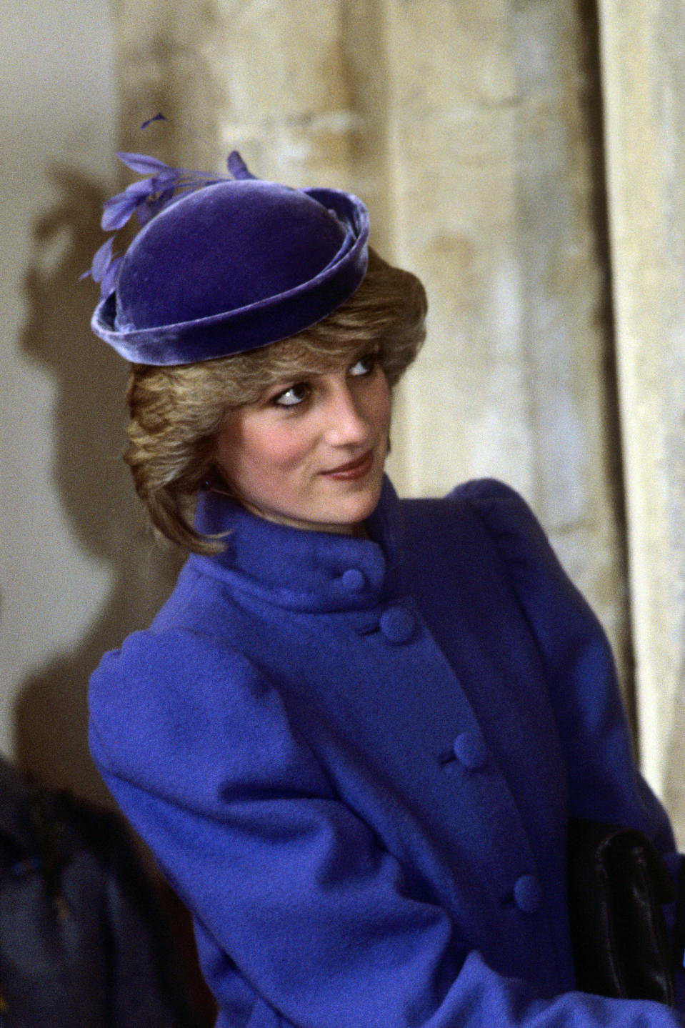 <p>Here, Princess Diana is pictured in Leckhampton, as she embarks on a tour of the Sue Ryder Home. For the royal engagement, she opted for a velvet hat to co-ordinate her violet coat.<br><em>[Photo: PA]</em> </p>