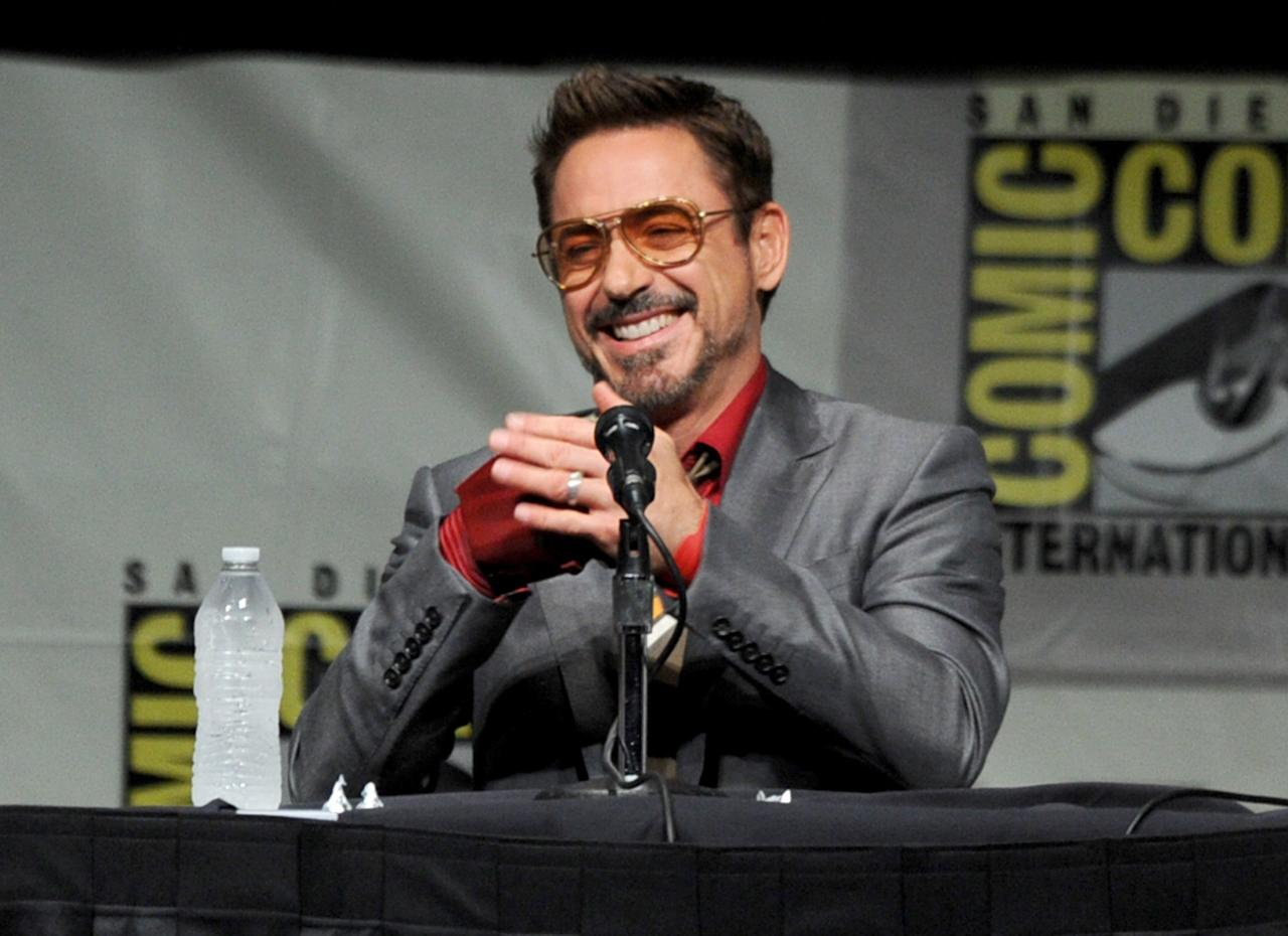 "SAN DIEGO, CA - JULY 14:  Actor Robert Downey Jr. speaks at Marvel Studios ""Iron Man 3"" panel during Comic-Con International 2012 at San Diego Convention Center on July 14, 2012 in San Diego, California.  (Photo by Kevin Winter/Getty Images)"