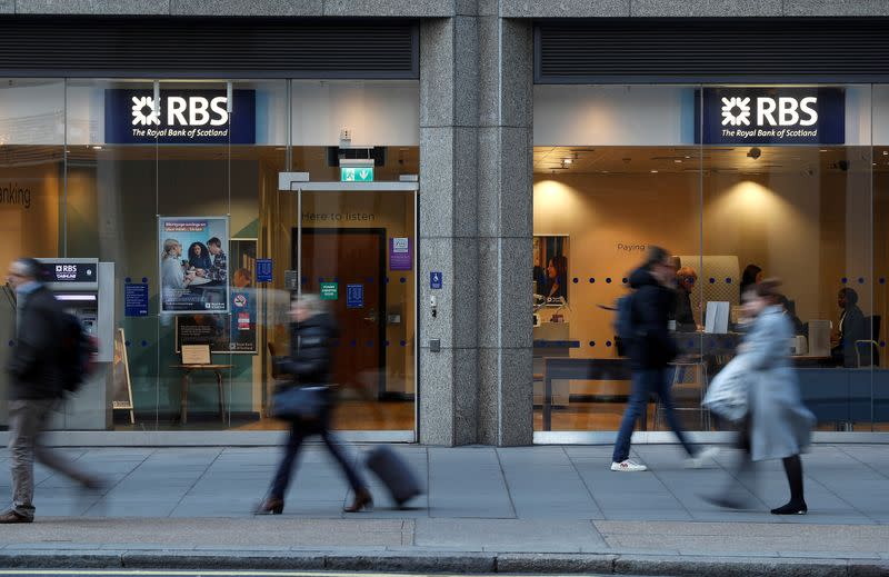 FILE PHOTO: People walk past a branch of the Royal Bank of Scotland in London