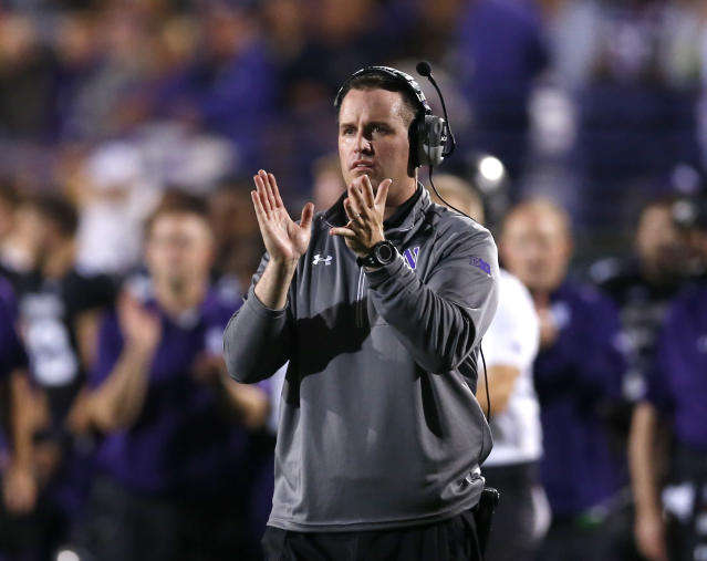 Northwestern head coach Pat Fitzgerald applauds his team during the first half of an NCAA football game against Ohio State, Saturday, Oct. 5, 2013, in Evanston, Ill. (AP Photo/Charles Rex Arbogast)