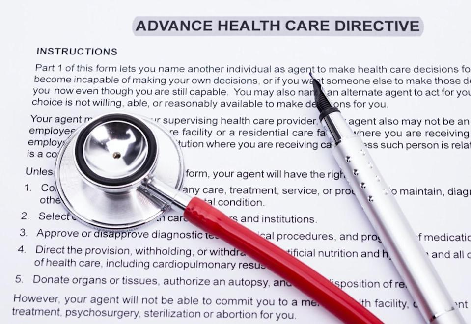Image shows an advanced directive, a stethoscope and a pencil