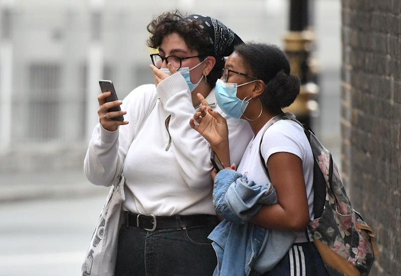 Students Freya Johnson and Zeynep Okur outside the Department for Education building in London on Monday, reacting to news of the U-turn. (PA)