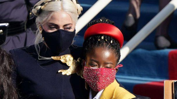 PHOTO: Lady Gaga poses with Amanda Gorman during the inauguration of Joe Biden as the 46th President of the United States on the West Front of the U.S. Capitol in Washington, D.C., Jan. 20, 2021. (Kevin Lamarque/Reuters)