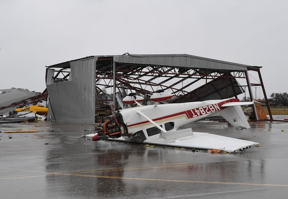A light plane sits upside done at Rockport Airport.