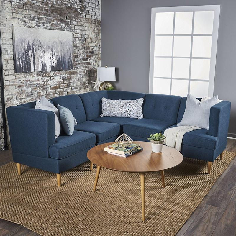 "<a href=""https://www.amazon.com"" target=""_blank"">Amazon</a> is already a huge competitor when it comes to easy and fast delivery, so it makes sense that they'd sell furniture that's also competitive in that space. They have <a href=""https://www.amazon.com"" target=""_blank"">tons of options</a> that make putting together and taking apart furniture simple, like this 5pc <a href=""https://www.amazon.com/Mid-Century-Sectional-Comfortable-Convertible-Interlocking/dp/B0753VJHFN/ref=sr_1_1_sspa?ie=UTF8&qid=1508346433&sr=8-1-spons&keywords=modular+furniture&psc=1"" target=""_blank"">Mid-Century Tufted Modular Sectional Sofa by Milltow</a>n."