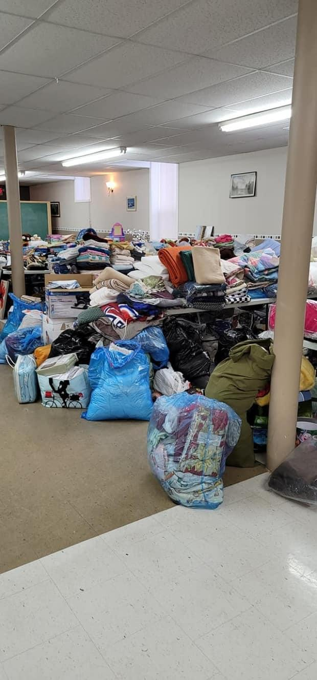 Mayor Jean-Pierre Ouellet said the newcomers will only be bringing two suitcases each with them, so they need a lot of household goods.