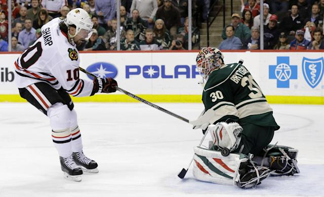 Minnesota Wild goalie Ilya Bryzgalov (30), of Russia, deflects a point-blank shot by Chicago Blackhawks left wing Patrick Sharp (10) during the second period of Game 6 of an NHL hockey second-round playoff series, in St. Paul, Minn., Tuesday, May 13, 2014. (AP Photo/Ann Heisenfelt)