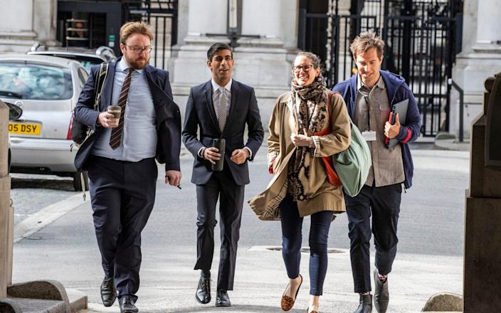 Rishi Sunak arrives at Downing Street with his team in May 2020 - Heathcliff O'Malley