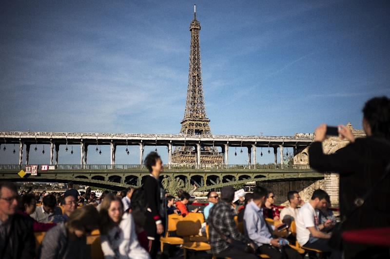 Carbon taxes on air travel to mitigate pollution could hurt the tourism industry (AFP Photo/LIONEL BONAVENTURE)