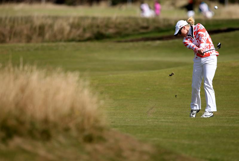 Morgan Pressel of the US plays her shot on the 15th fairway during the third round of the Women's British Open golf championship on the Old Course at St Andrews, Scotland, Sunday Aug. 4, 2013.Play in the third round was suspended on Saturday due to high winds (AP Photo/Scott Heppell)
