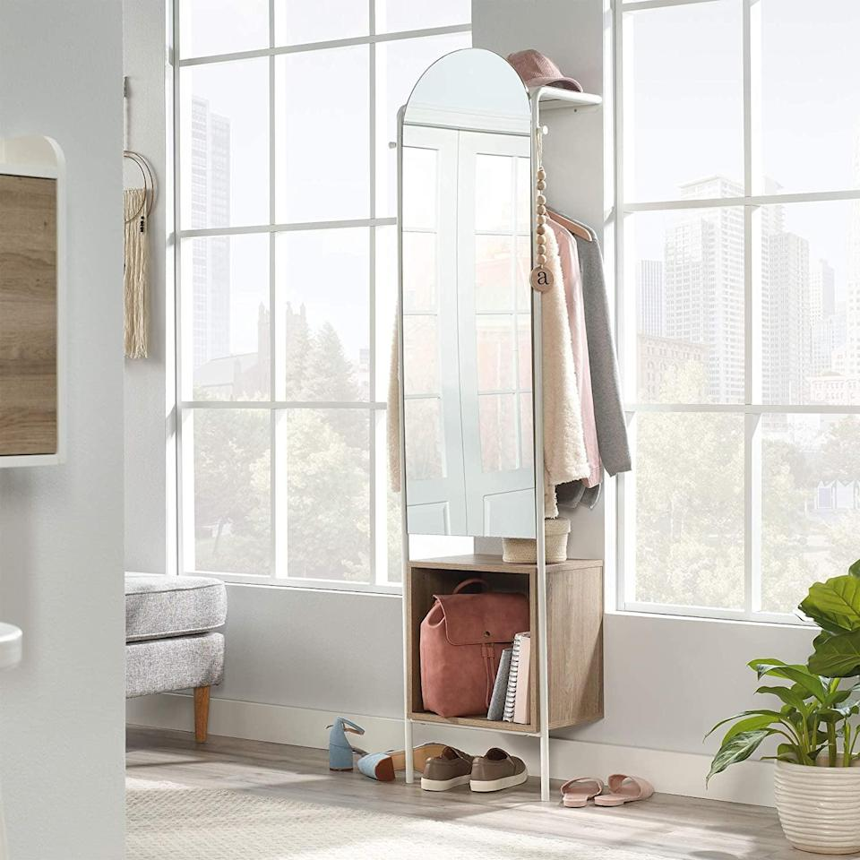 <p>From coats and outerwear to boots, umbrellas, and bags, the <span>Sauder Anda Norr Entryway Storage</span> ($174, originally $185) lets you store everything you need before you head out. It's a wall-supported storage solution that is durable and takes up minimal space. It even has a mirror so you can check to make sure you look your best. </p>