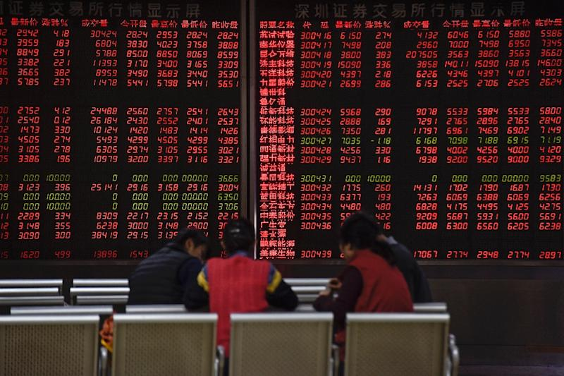 Chinese stocks were up solidly by lunch on January 19, 2016, with the benchmark Shanghai Composite Index rising 1.64% to 2,961.58, while the Shenzhen Composite Index, which tracks stocks on China's second exchange, gained 1.41% to 1,856.09 (AFP Photo/Fred Dufour)